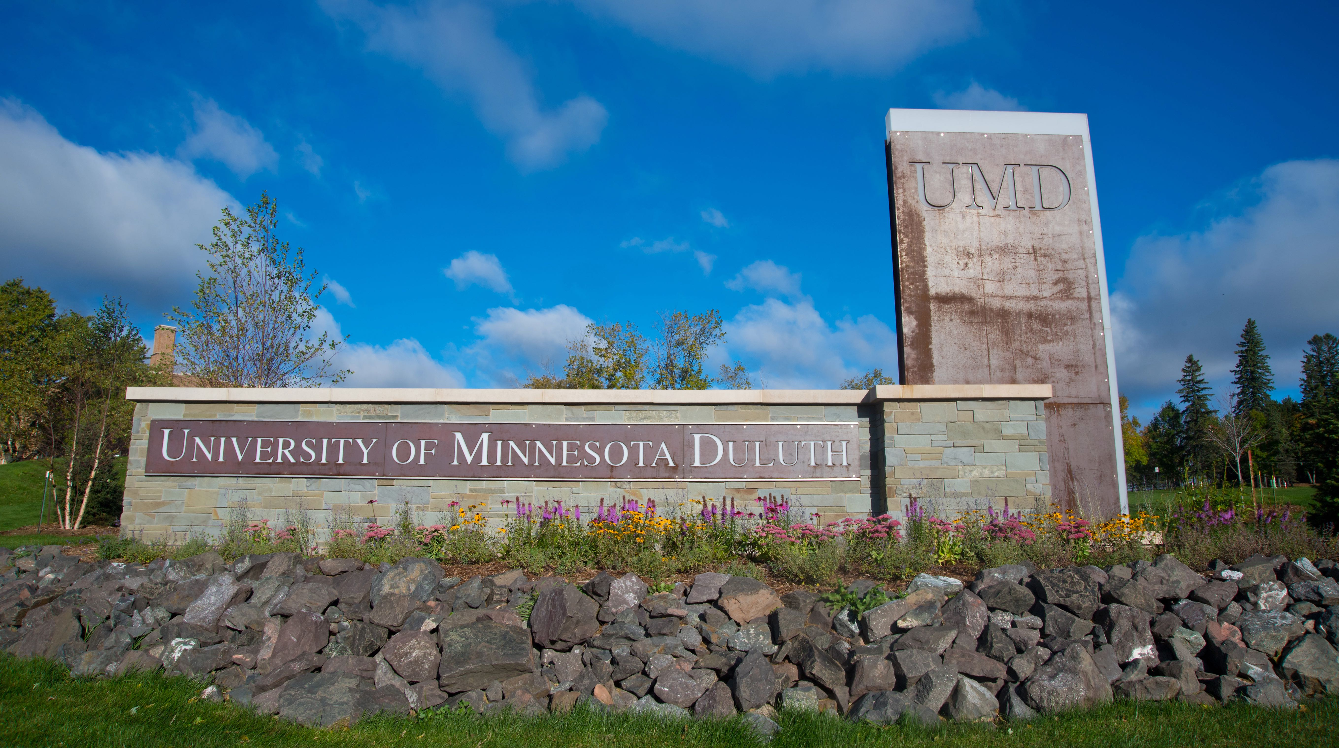 UMD brick sign with blue sky in the background