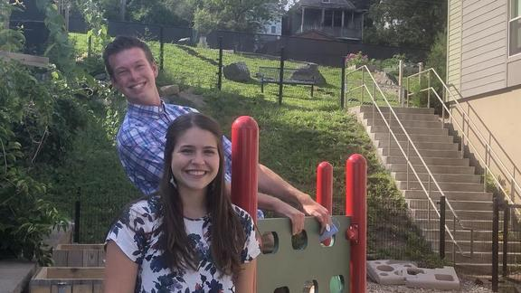 Max Krueger and Kate Strehlke pose by playground equipment