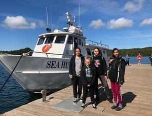 Four participants in the Voyage of Discovery Program: Nedda Ramona Raine, Amelie Raine, Annelise Hecker and (front) Madison Sundvick