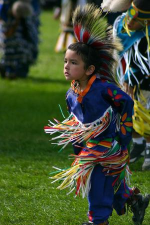 American Indian child dancing at a pow wow