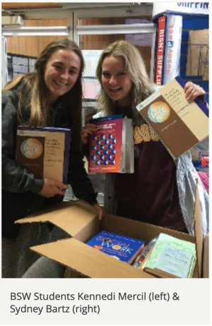 BSW Students Kennedi Mercil & Sydney Bartz holding up books they collected during a drive
