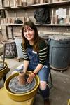 Maren Friemann sitting at a potter's wheel
