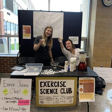 exercise science club tabling in Kirby with protein shakes