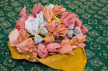 tobacco wrapped as gifts piled into a basket