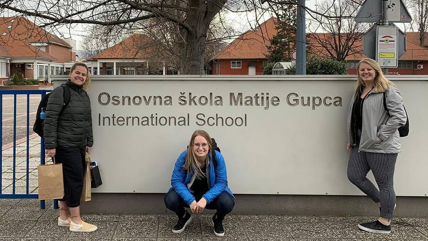 Cass, Megan, Lexi in front of the Croatian school