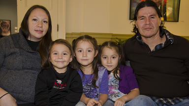 An American Indian family, smiling