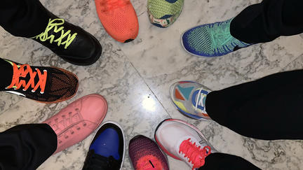 people with bright neon shoes in a circle