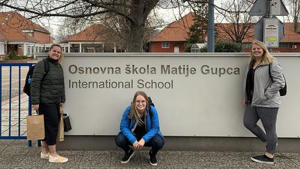 Cass, Megan, Lexi in front of the Croatian school