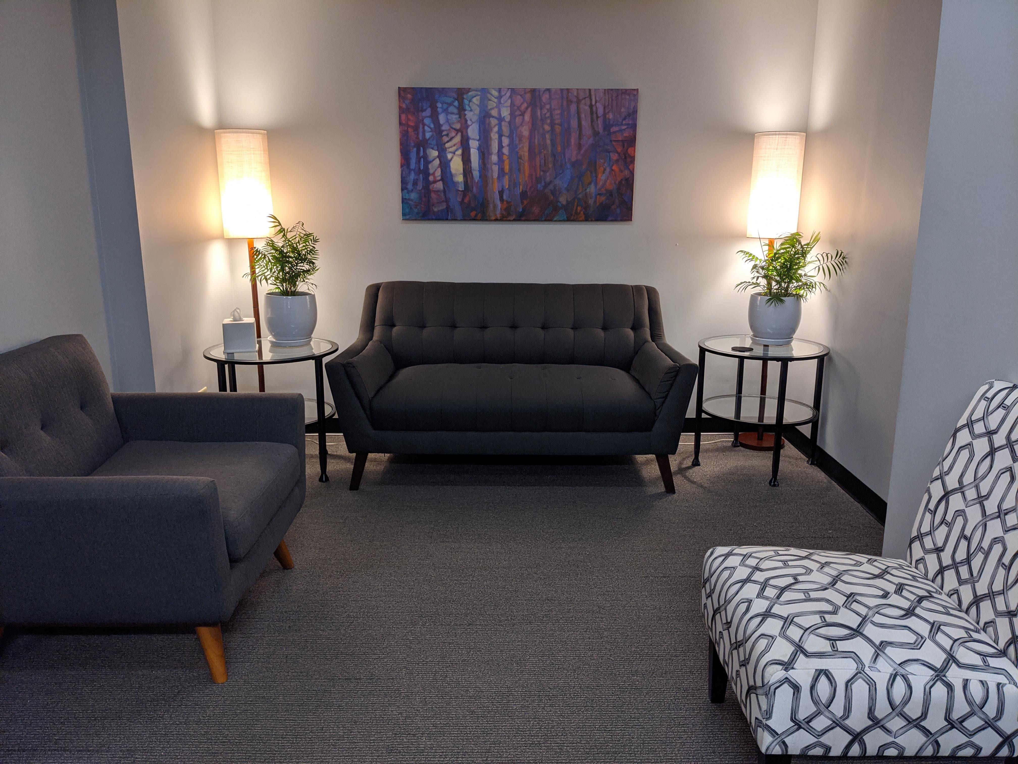 waiting area for MAP Behavioral Health Center with couches, soft lamp lights, and plants on two end tables